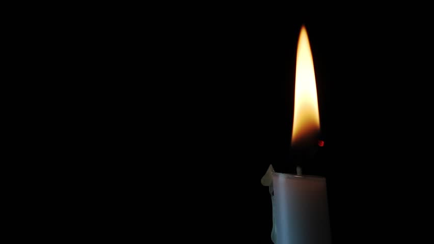 Looping, Single white candle with flickering flame shining into the darkness. Excellent text space!