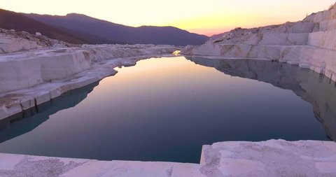 CIRCA 2010s - Macedonia - Beautiful aerial over a marble quarry at dawn.