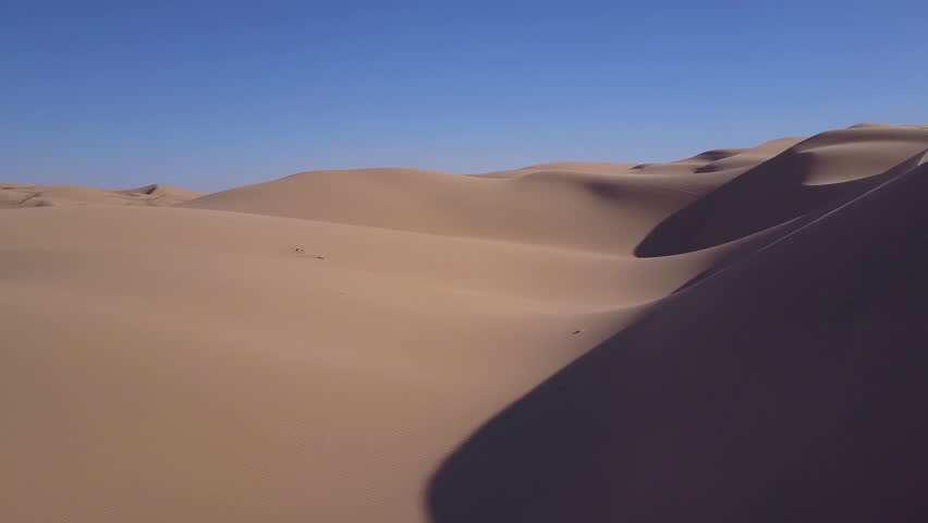 CIRCA 2010s - Imperial Sand Dunes, California - Dune buggies and ATVs race across the Imperial Sand Dunes in California.   Shutterstock HD Video #31373473