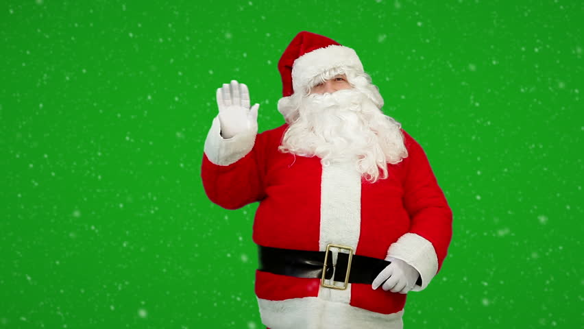 Santa claus holding a box with christmas gift on the snow background santa claus is greeting and waving his hand with merry christmas holiday wishes on the greenscreen m4hsunfo Images