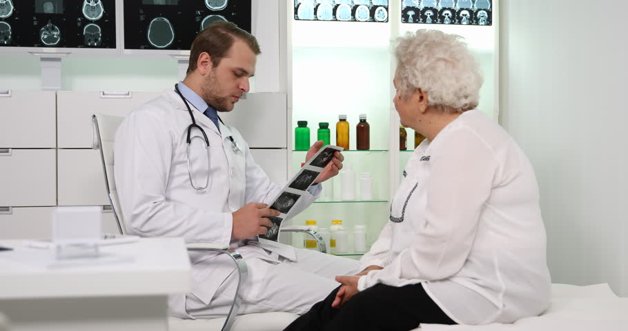 Hospital Medical Doctor Man Talk with Elderly Patient Ultrasound Clinical Result | Shutterstock HD Video #31434919