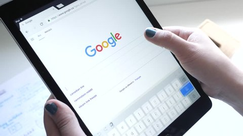 Girl making a search in Google on her Tablet