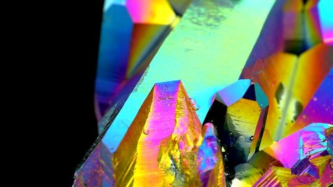 Very sharp and detailed Titanium rainbow aura quartz crystal cluster stone on rotating platform with amazing light reflections effects (60fps)