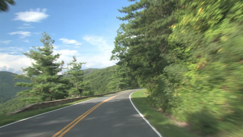 Driving on the road in the mountains