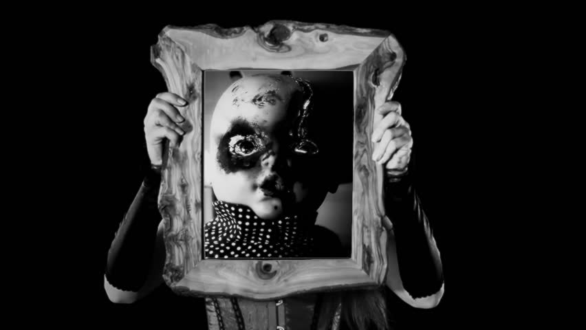 A sexy girl holding a wooden frame with a scene: a haunted doll, eyes burned, looking at the viewer, on a moving rocking chair. Scary Halloween horror black-and-white shot.