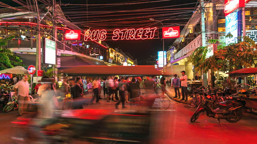 SIEM REAP, CAMBODIA-DECEMBER 9, 2012: Timelapse view of tourists walking in Siem Reap Pub Street, Angkor, Cambodia on December 8, 2012.