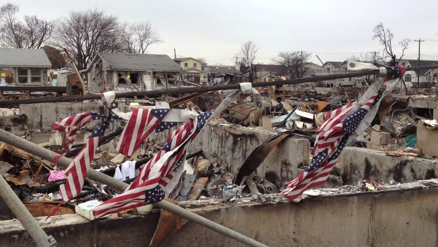 BREEZY POINT, QUEENS, NY - December 2, 2012: Video clip of wreckage and debris from fire from Hurricane Sandy.  Draped American flags are tied to cable to show strength of country and community.