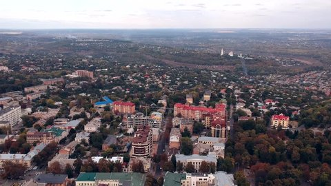 Aerial view on Poltava city, Ukraine. Old video style, low light evening autumn footage