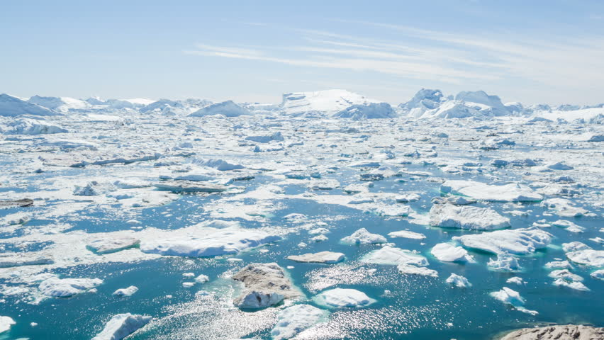 Iceberg and ice from glacier in arctic nature landscape on Greenland. Aerial video drone footage of icebergs in Ilulissat icefjord. Affected by climate change and global warming. | Shutterstock HD Video #31522969