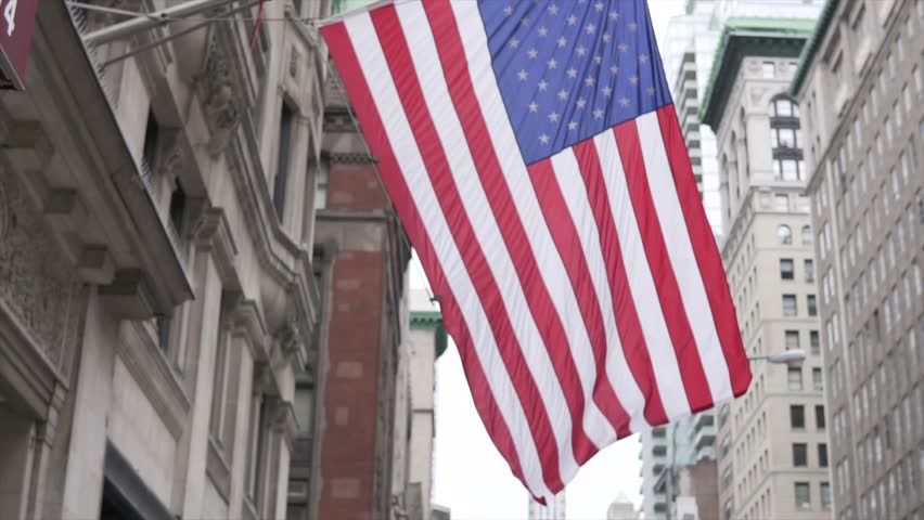 AMERICAN FLAG IN SLOW MOTION. NEW YORK, NY, NEW YORK CITY Streets. Walking in New York