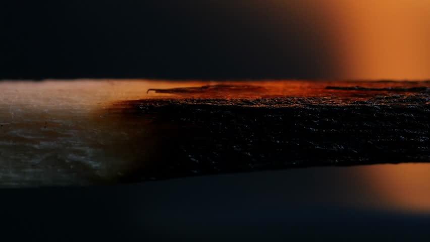 Burning Match On Black Background Macro
