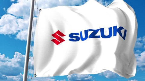Waving flag with Suzuki Motor logo against clouds and sky. 4K editorial animation