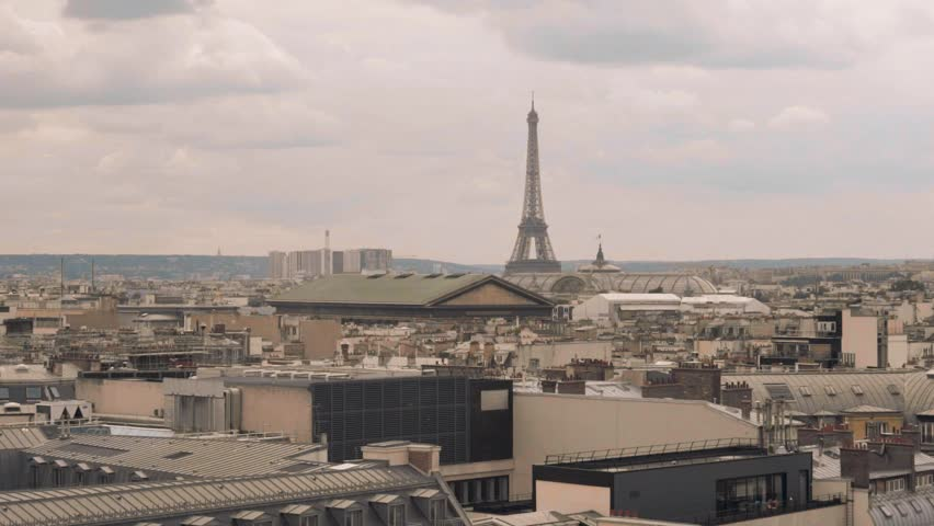 Paris roofs and Eiffel Tower. Beautiful roofs view in Paris City downtown with skyline under sunlight at day time. | Shutterstock HD Video #31636729
