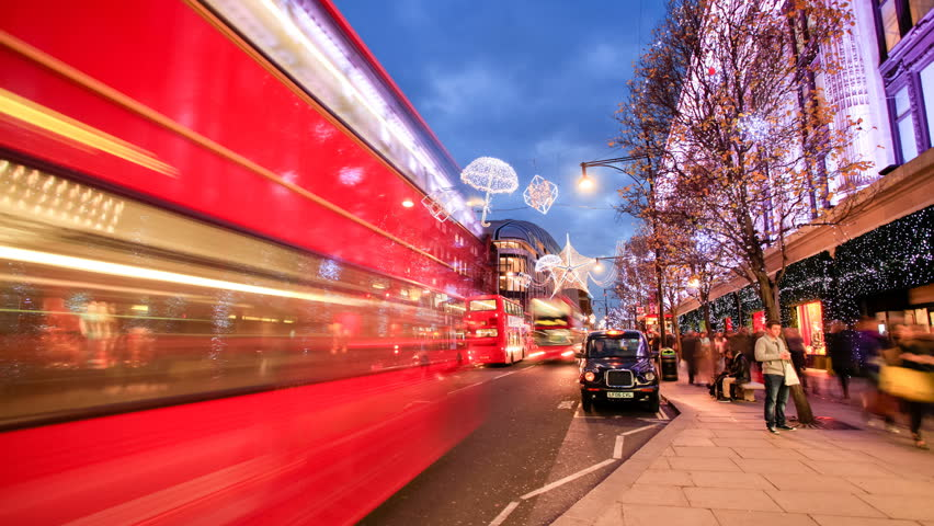 LONDON - DEC 10: Timelapse view of Oxford Street at night before Christmas with Traffic and people walking on 10 December 2012  in London, United Kingdom