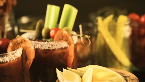 Bloody mary cocktail bar with variety of garnishes.