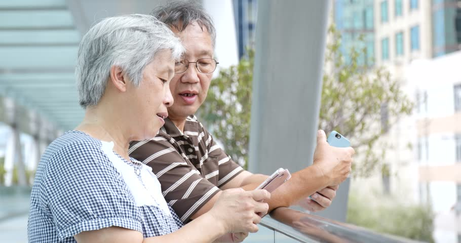 Senior couple using mobile together at outdoor  | Shutterstock HD Video #31669069