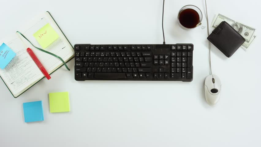 Top down view of man working by computer using keyboard and mouse | Shutterstock HD Video #31678822