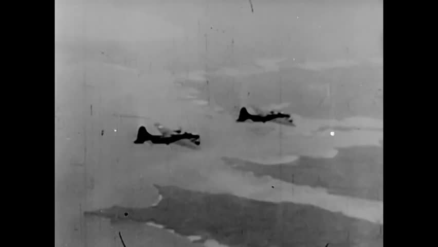 CIRCA 1943 - Boeing B-17 Flying Fortresses drop bombs on harbor installations in Wilhelmshaven, Germany and aerial combat ensues during World War 2.