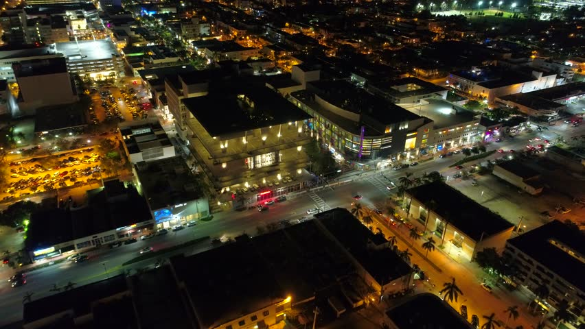 MIAMI BEACH, FL, USA - OCTOBER 9, 2017: Aerial night video of Miami Beach Lincoln Road shot with a drone | Shutterstock HD Video #31706014