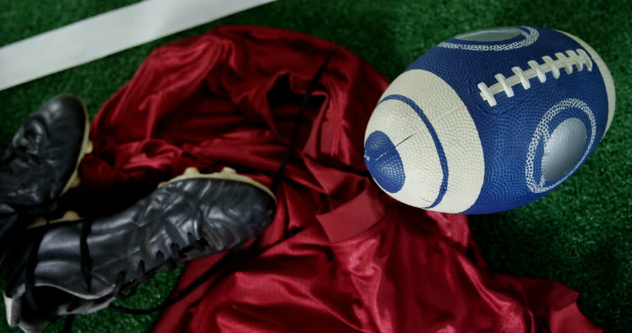 Overhead of cleats, jersey and rugby ball on artificial turf 4k #31718488