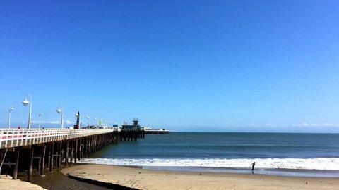 SANTA CRUZ, CA, USA - 30 APRIL 2017: Santa Cruz Wharf at Covells Beach, Santa Cruz, California in 2017. With a length of 2,745 feet (836.68 m), it is the longest pier on the West Coast of the US.