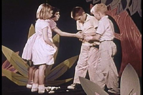 CIRCA 1950s - Kids collect seashells and fight over a hamster on an island of make believe in this strange 1950s clip.