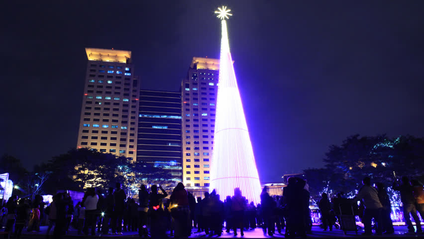NEW TAIPEI CITY, TAIWAN - CIRCA DECEMBER 17,2012: (Time lapse) People gathering together at The Civic Plaza of New Taipei City and enjoy the Christmas tree light show held before the Christmas.