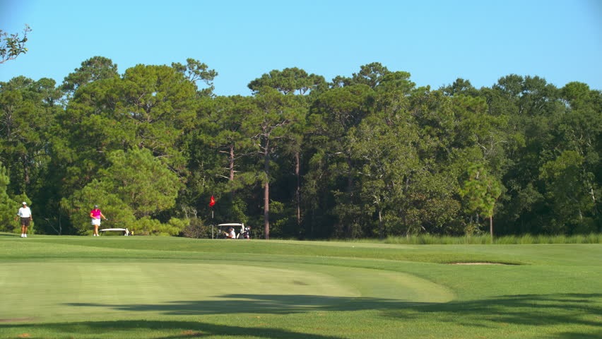 Generic Golf Course Action with Players Enjoying a Lush Green Grass Environment on a Sunny Day near Myrtle Beach South Carolina