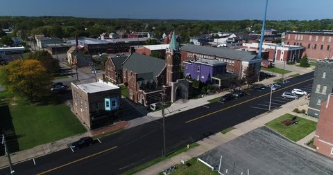 A slowly moving forward aerial establishing shot of a church in the small town of Salem, Ohio on an early Autumn day.