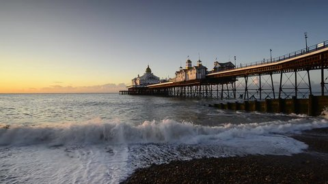 Sunrise over the pier at Eastbourne in Sussex on the south coast
