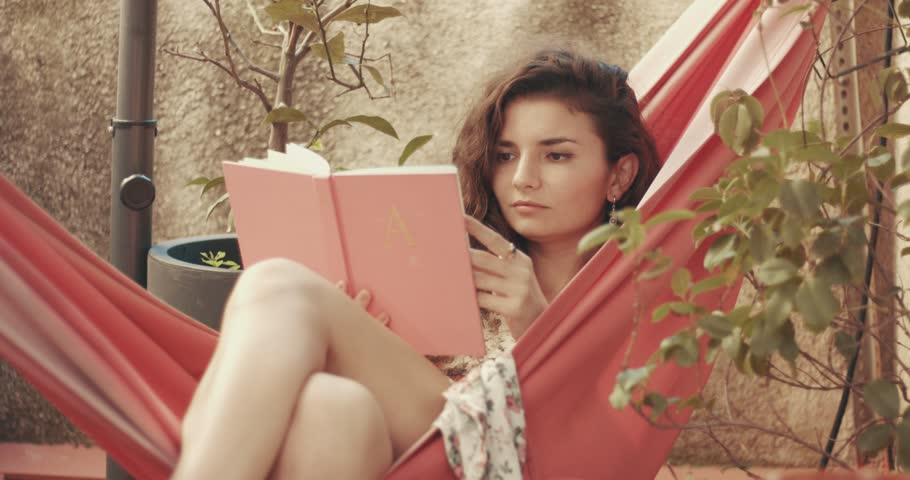 Pretty Red Haired Young Woman In Fl Dress Reads A Book Hammock