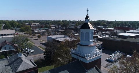A slow forward daytime dolly aerial establishing shot of the small town of Salem, Ohio's business district.