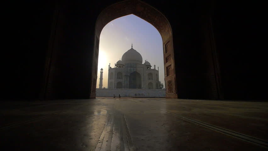 A shot approaching the Taj Mahal through an archway at sunset | Shutterstock HD Video #31803679