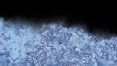 Beautiful frozen window melting animation from top to bottom, timelapse defrost transition, natural dissolve, isolated on black background with black and white luminance matte, alpha channel.