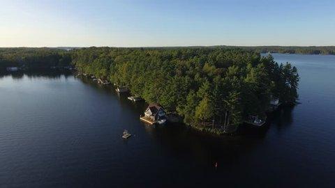 aerial beautiful cottages on lake muskoka reverse flight scenery