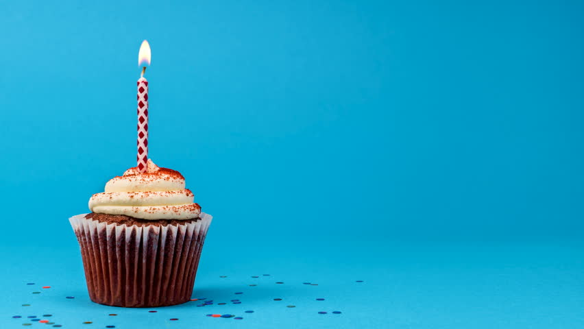 Cupcake party with candle on blue background cinemagraph seamless loop.