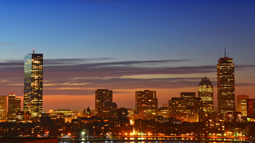 Timelapse of dramatic sunrise over Boston downtown time lapse as seen from Cambridge