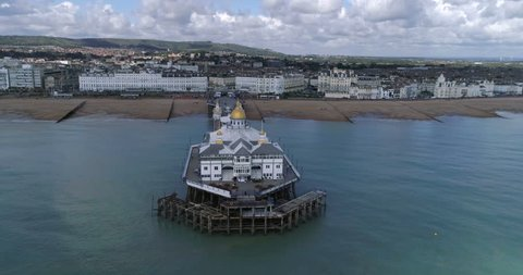 Aerial ascending view of the Victorian pier in Eastbourne, Southern England