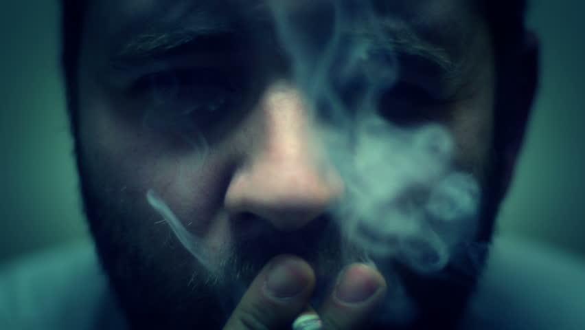SUPER 35MM CAMERA - Man smoking a cigarette  | Shutterstock HD Video #3188209