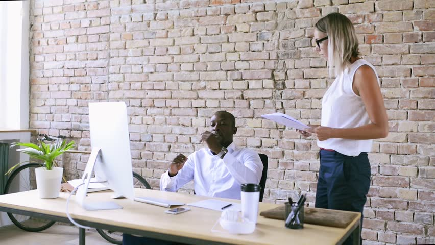 Two business people in the office working together. | Shutterstock HD Video #31899019