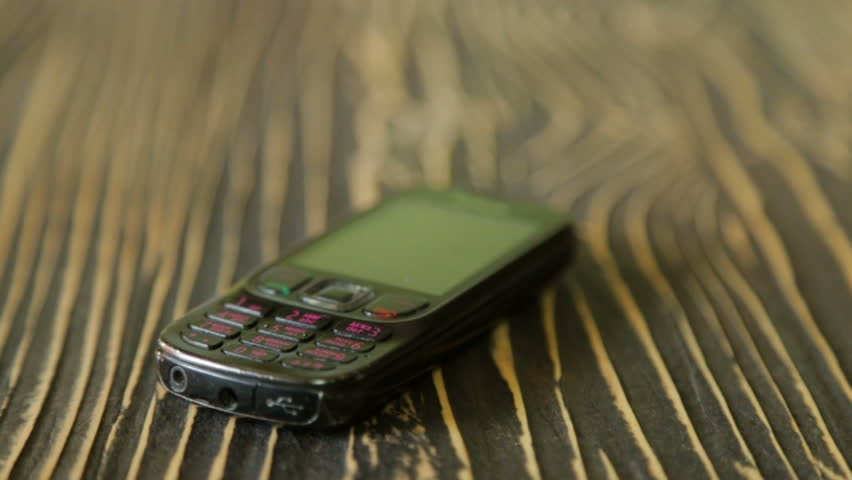 Shabby mobile phone on the texture table | Shutterstock HD Video #31910680