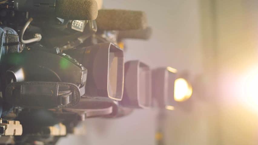 Video cameras in side view under bright light.    Shutterstock HD Video #31918519