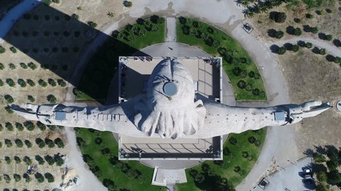 Aerial top-down footage of Sanctuary of Christ the King Portuguese Santuario de Cristo Rei is Catholic monument and shrine dedicated to Sacred Heart of Jesus Christ overlooking city of Lisbon Almada