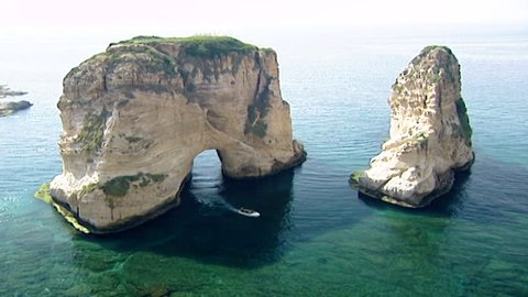 Pigeons Rock, Raouche, Beirut. Static WS of the Pigeons Rock aka Sabah Nassars Rock formation, with small motorboat nearby.