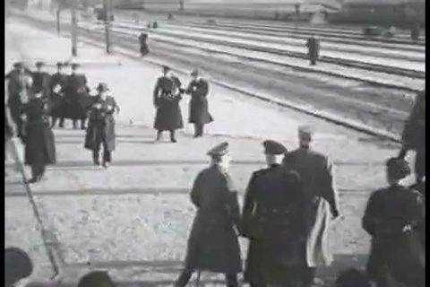 CIRCA 1930s - Adolf Hitler boards a passenger car and watches trains travel at an outdoor exhibition in Germany, in 1935.
