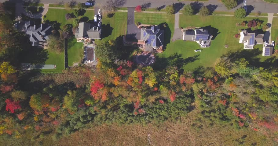 Ariel view of Flying over New England houses in the fall autumn season