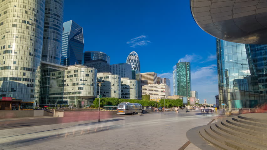 Skyscrapers of La Defense timelapse hyperlapse - Modern business and residential area in the near suburbs of Paris, France. Blue cloudy sky at sunny summer day. | Shutterstock HD Video #31971409