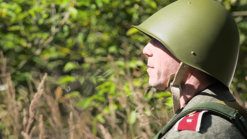 Soldier looking with his binoculars
