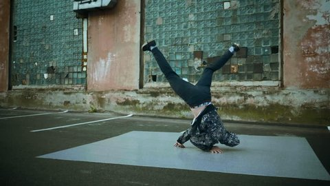 Hip-hop and breakdancing. Breakdancer dancing in the street. Slow motion. HD