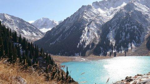 Spectacular view of emerald Big Almaty Lake in autumn season.